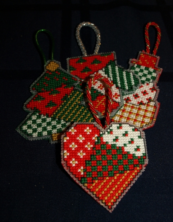 My fusible web backing technique needs a little work but for the first time I thought these plastic canvas ornaments turned out well.
