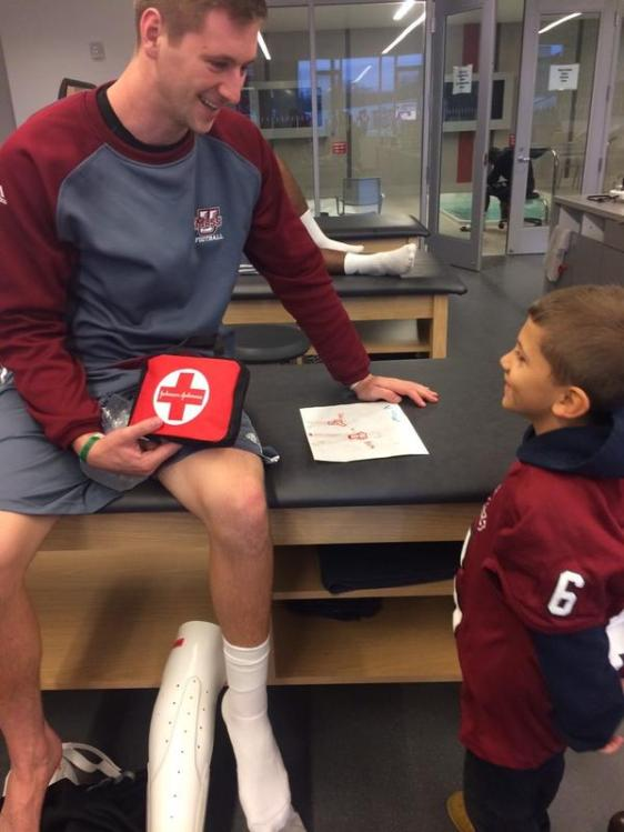 Jared visiting with Blake Frohnapfel, our injured quaterback. According to his mother, Jared wanted to make sure Blake's broken leg was ok and that he had enough bandaids. TOO CUTE!